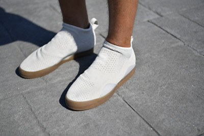 White Slip Ons on street