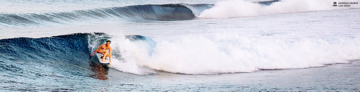 Lisa Veith surfing maldives