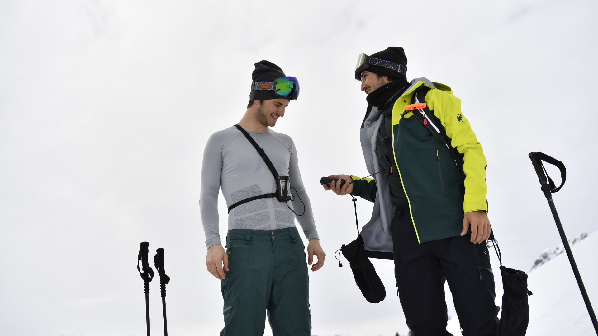 Two riders doing a transceiver check with 3-antenna models