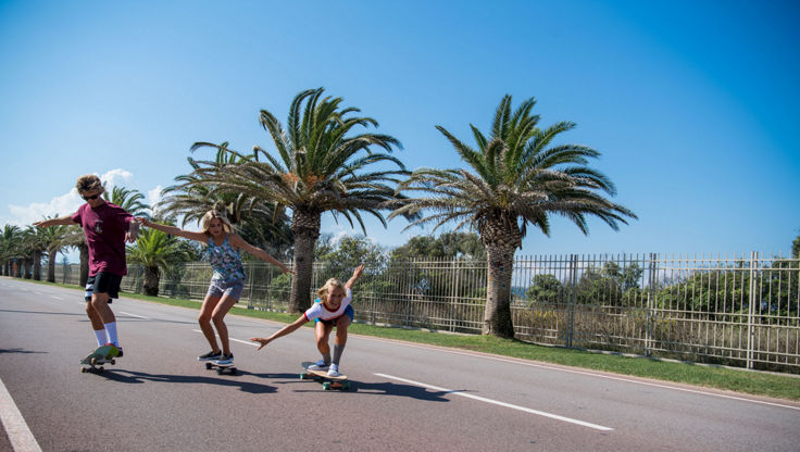 Young people riding on cruisers and longboards in Italy