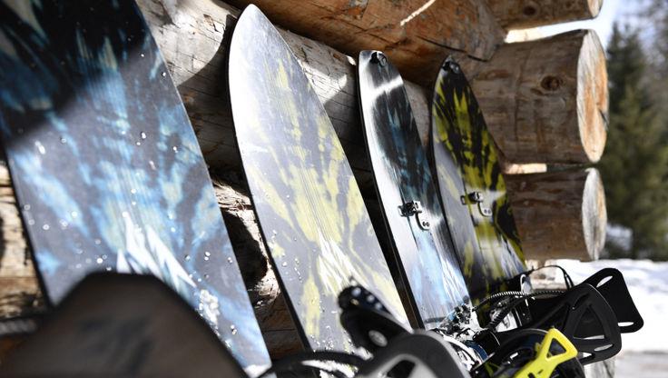 Directional splitboards leaning on a hut outside