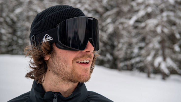 A Snowboarder wearing a pair of adidas Optics cylindrical goggles
