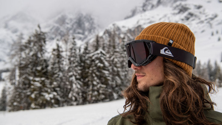 Male model wearing a small snowboard goggle