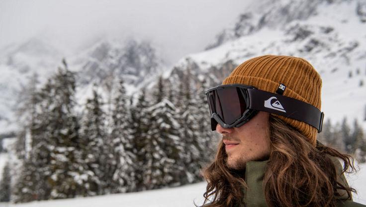 Male model wearing a small snowboard goggle