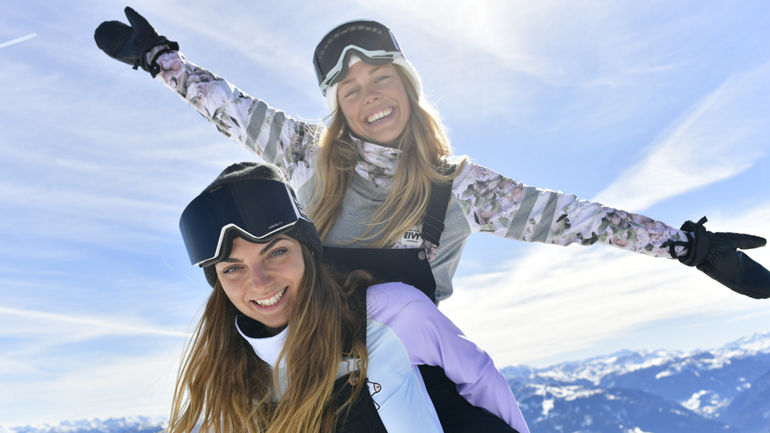 Snowboarders with baselayers
