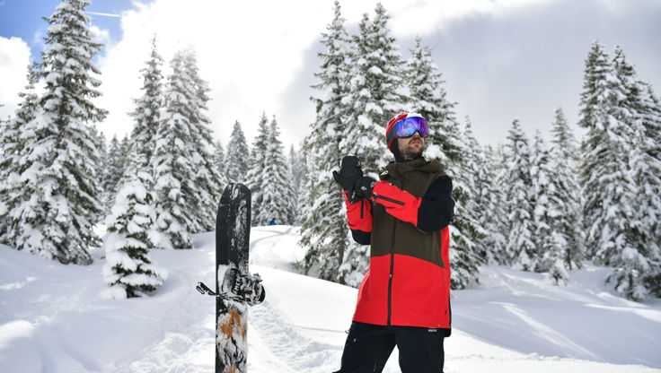 A snowboarder with an snowboard jacket