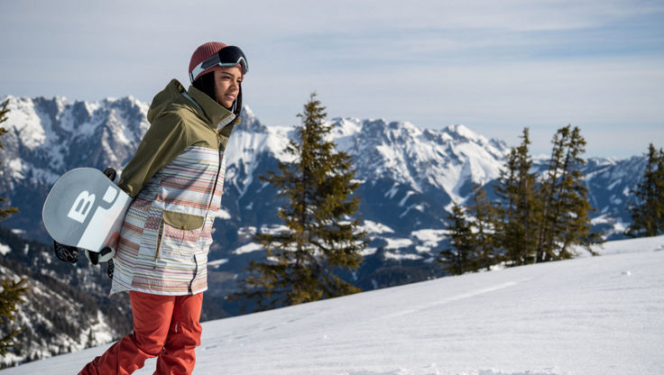 Female snowboarder wearing loose fit outerwear