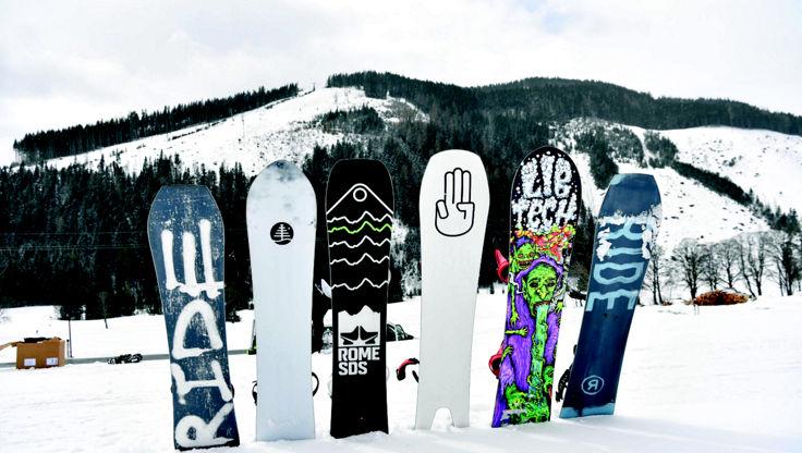 Snowboards lying base upwards from RIDE, Burton, Rome, Bataleon and Lib Tech
