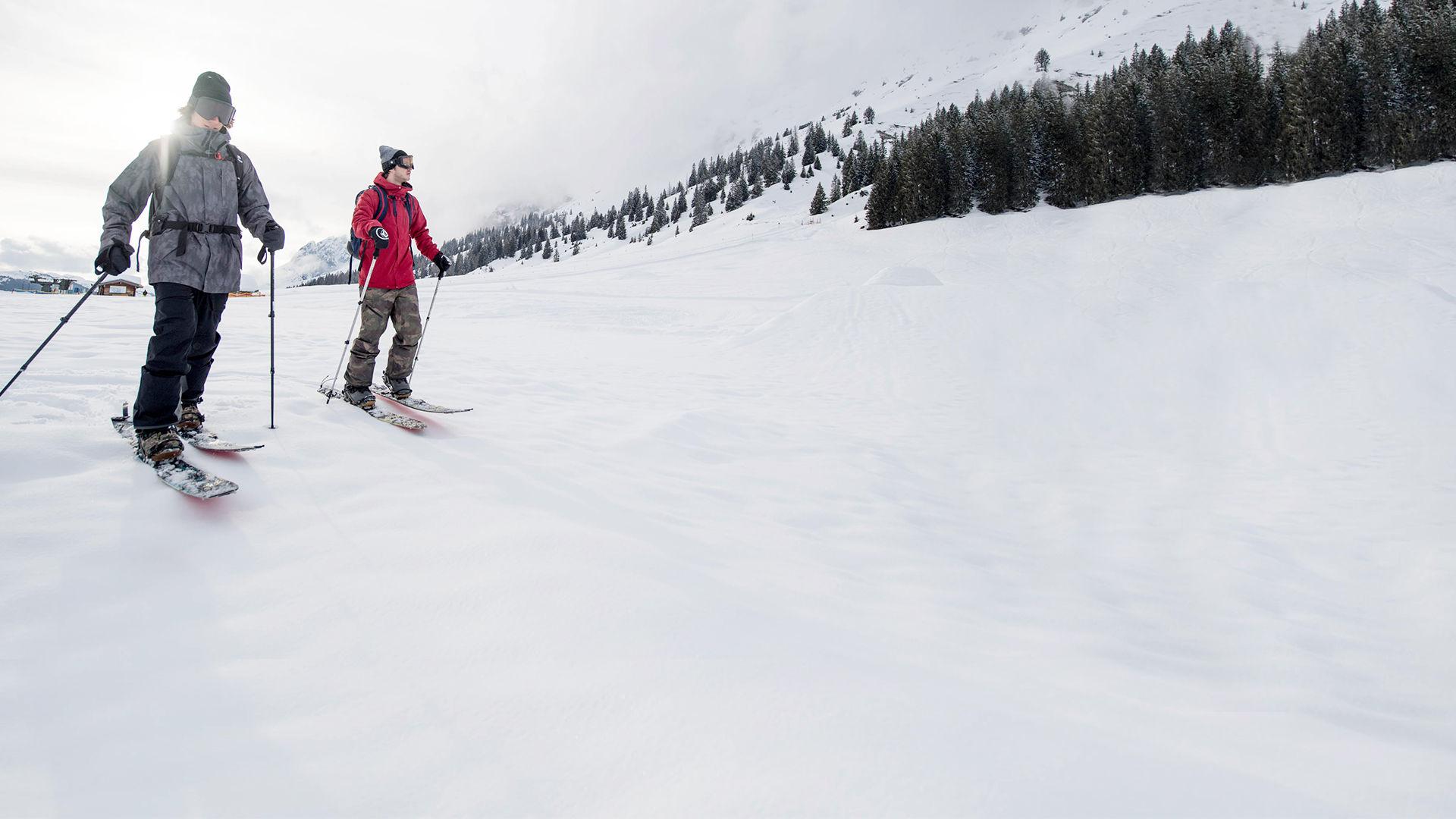 Two splitboarders taking a hike on the mountain
