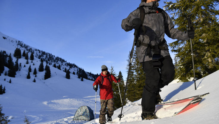 Two Freeriders hiking out to the backcountry with splitboards