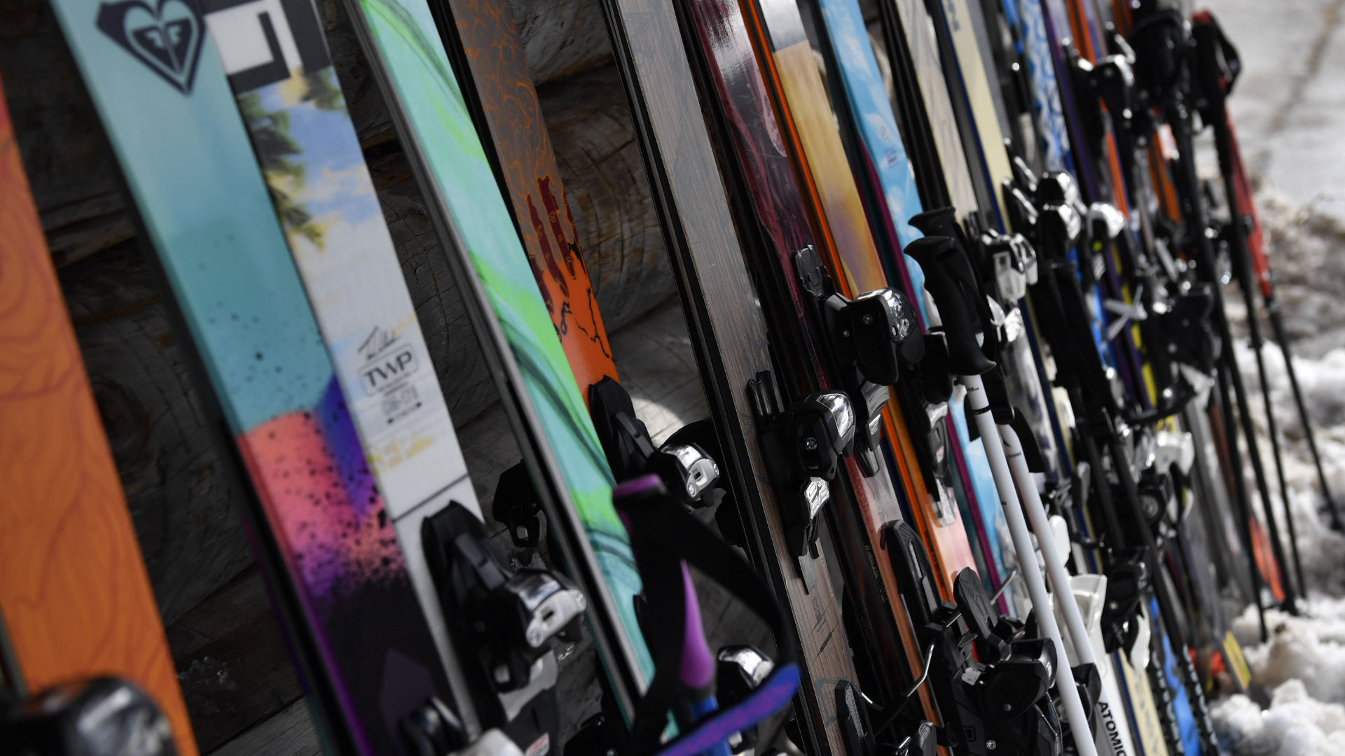 Variety of different skis with bindings