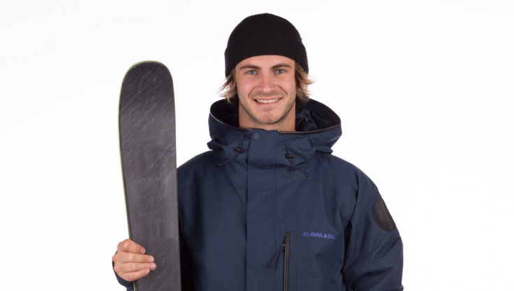 Model with a pair of all-mountain freeskis