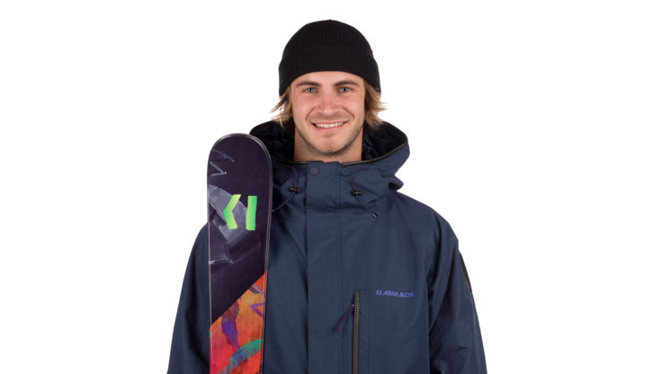 Model with a pair of beginner freeskis