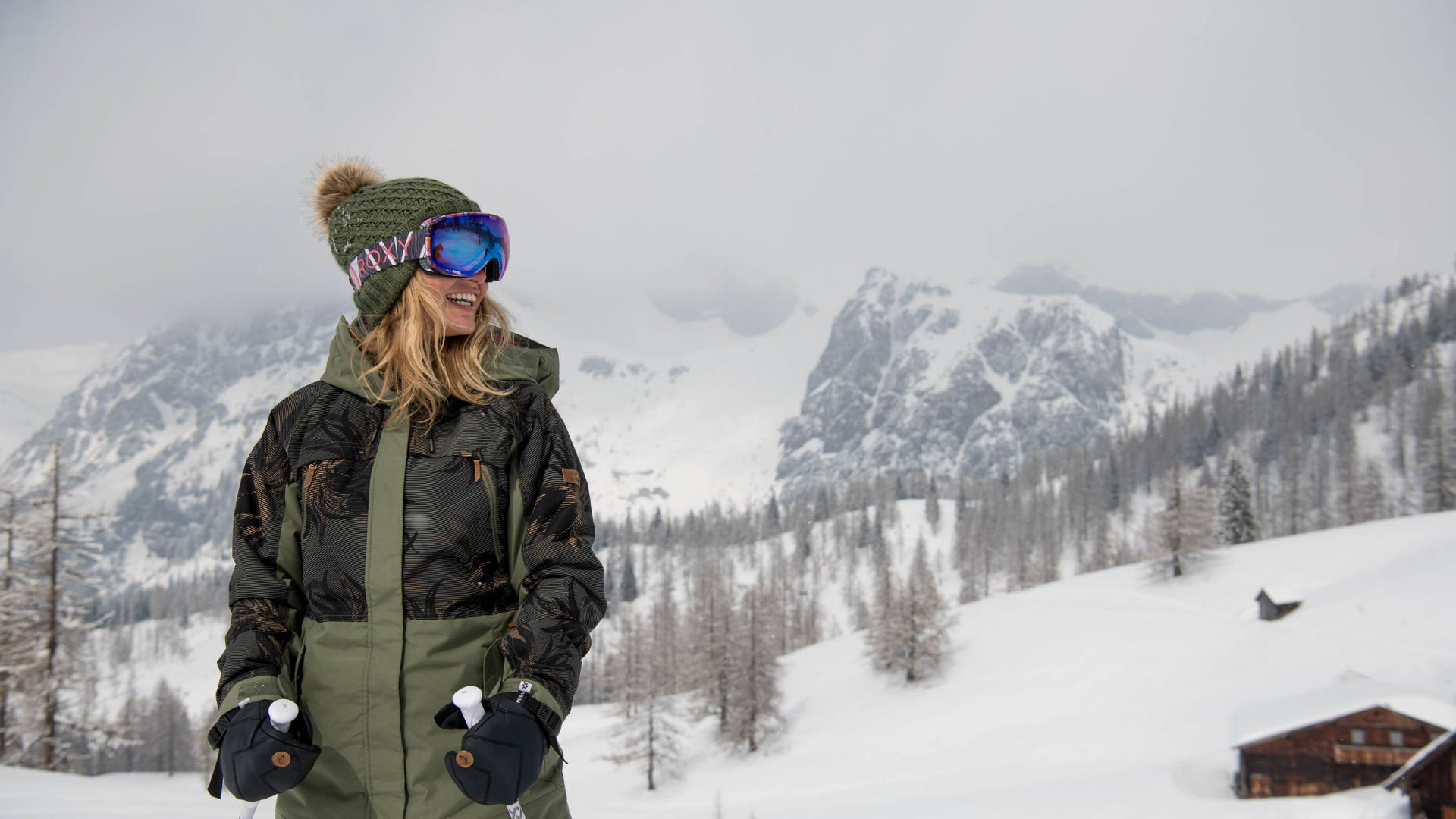 A female skier in changeable conditions in the mountains