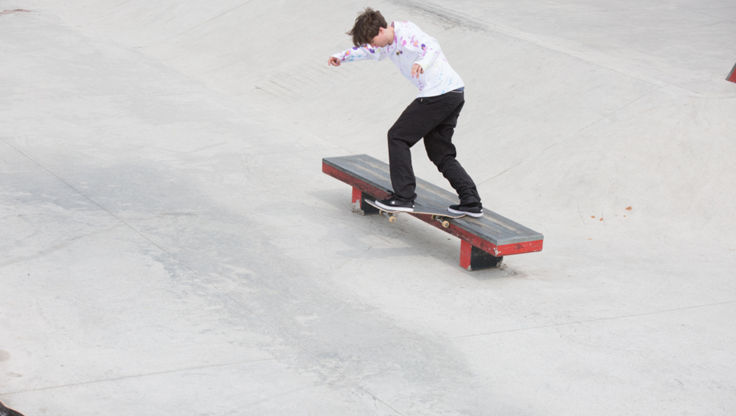 Sliding with a skateboard on a bench in the skatepark