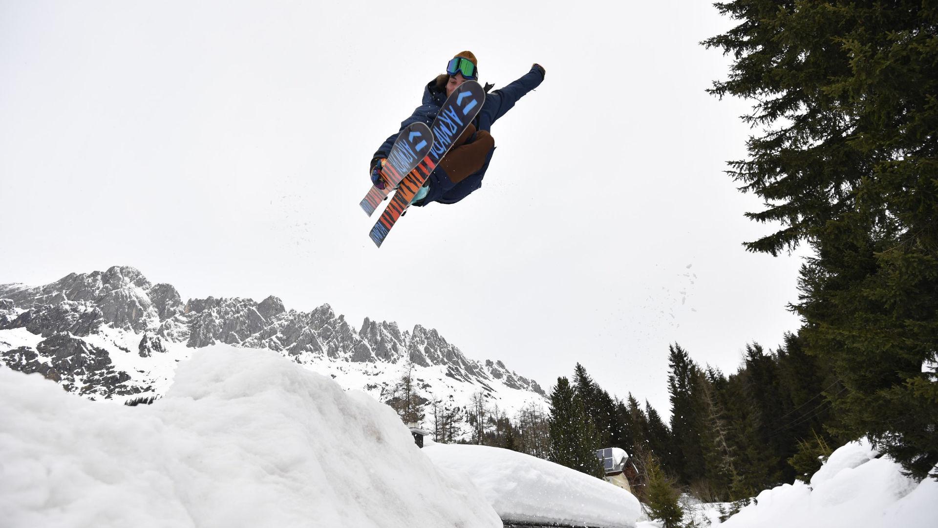 Freeskier taking air off a kicker