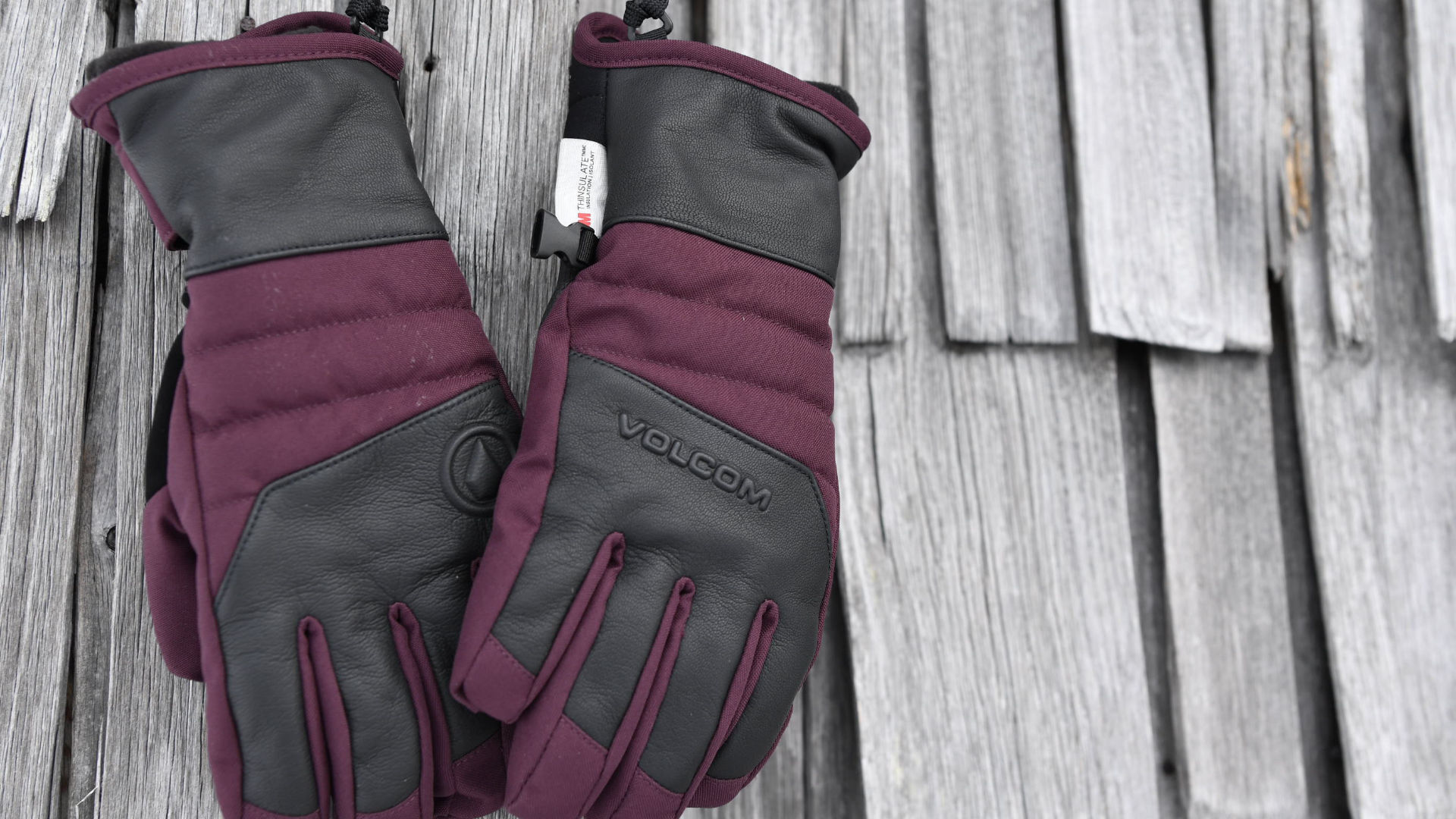 a pair of Volcom gloves on wooden plates