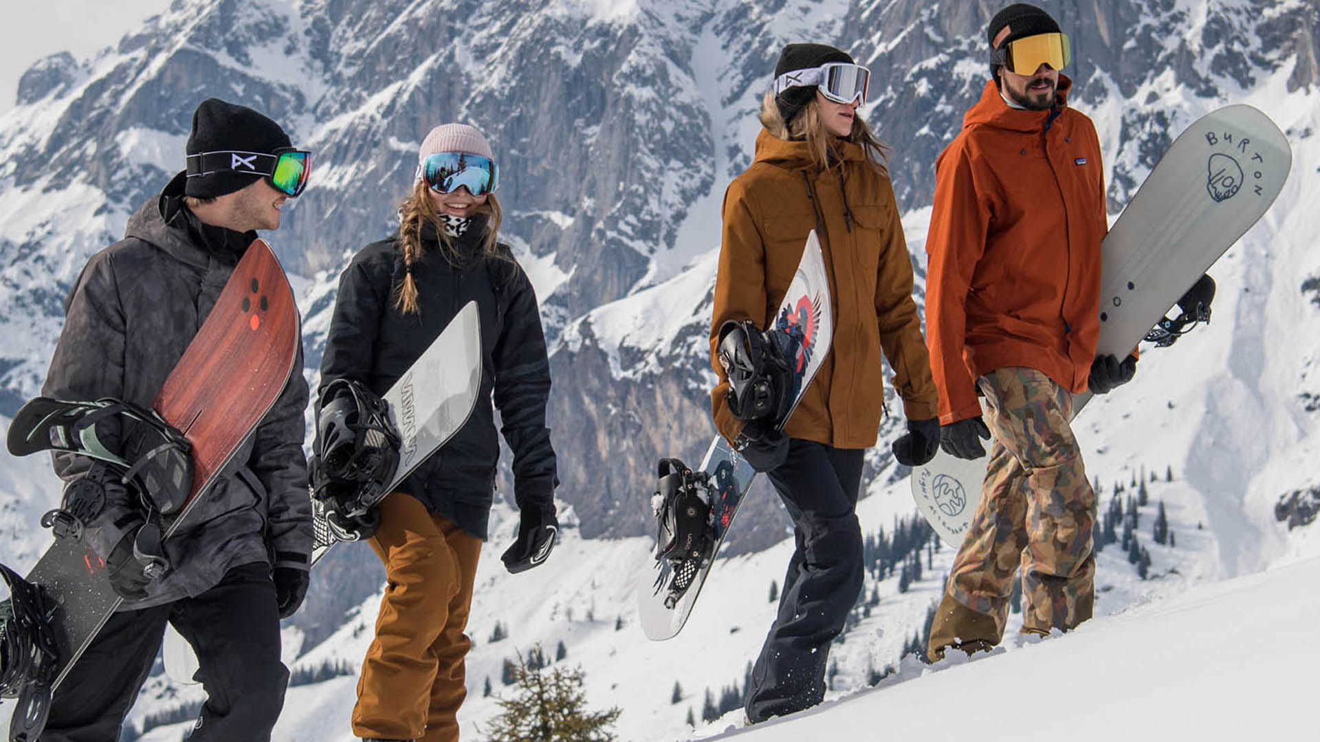 Four snowboarder hiking up the mountain