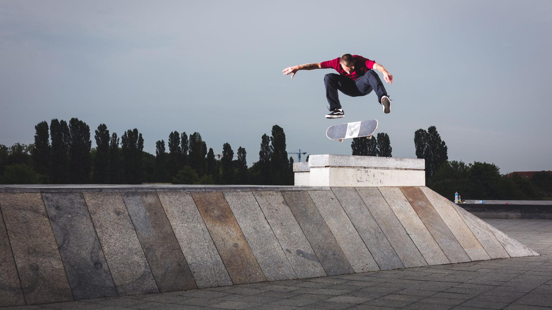 Rider doing a kickflip in the skatepark