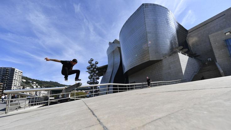 Skateboarder doing a high kickflip