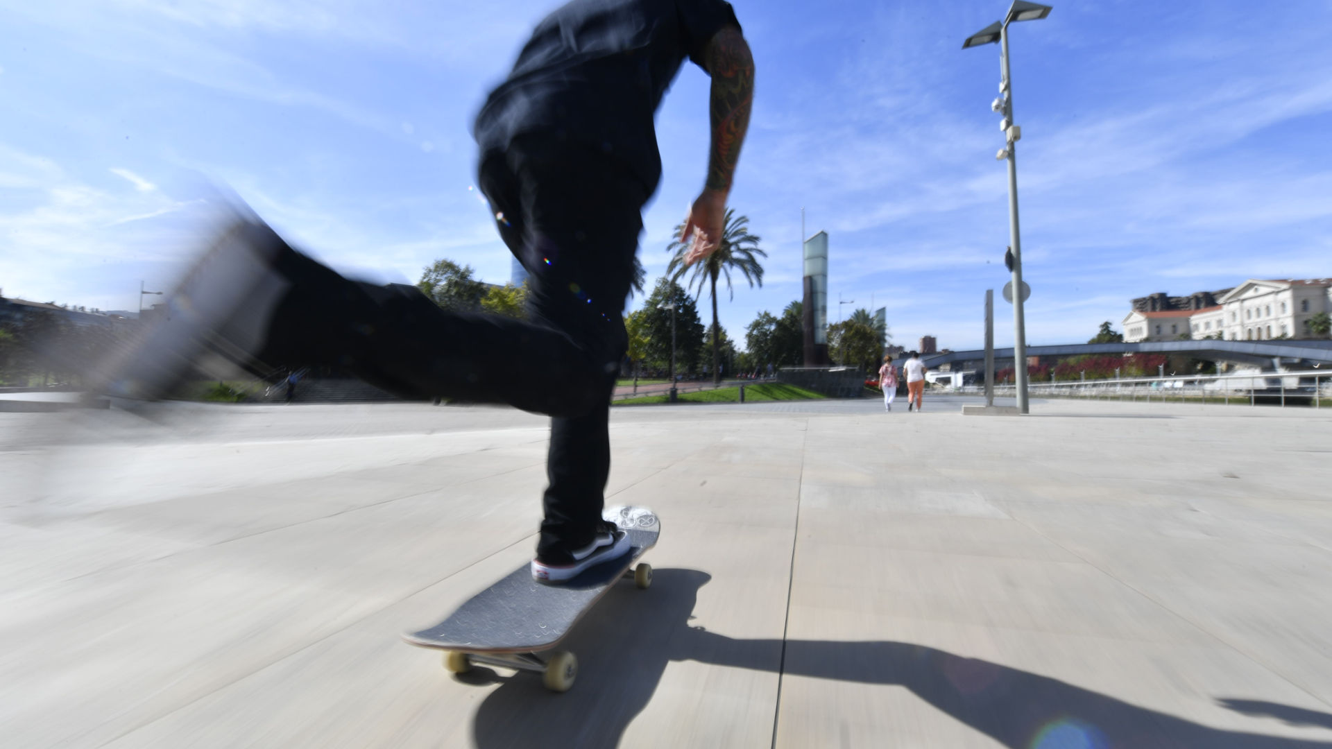 Riding a skateboard in Spain with a foot securely on the board