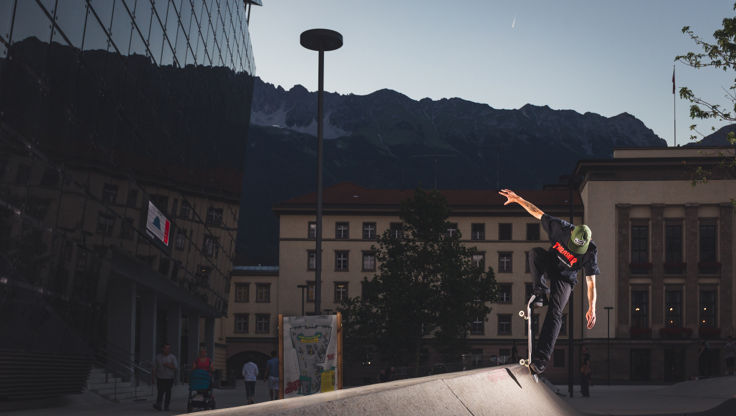 Riding a urban feature with hard skateboard wheels