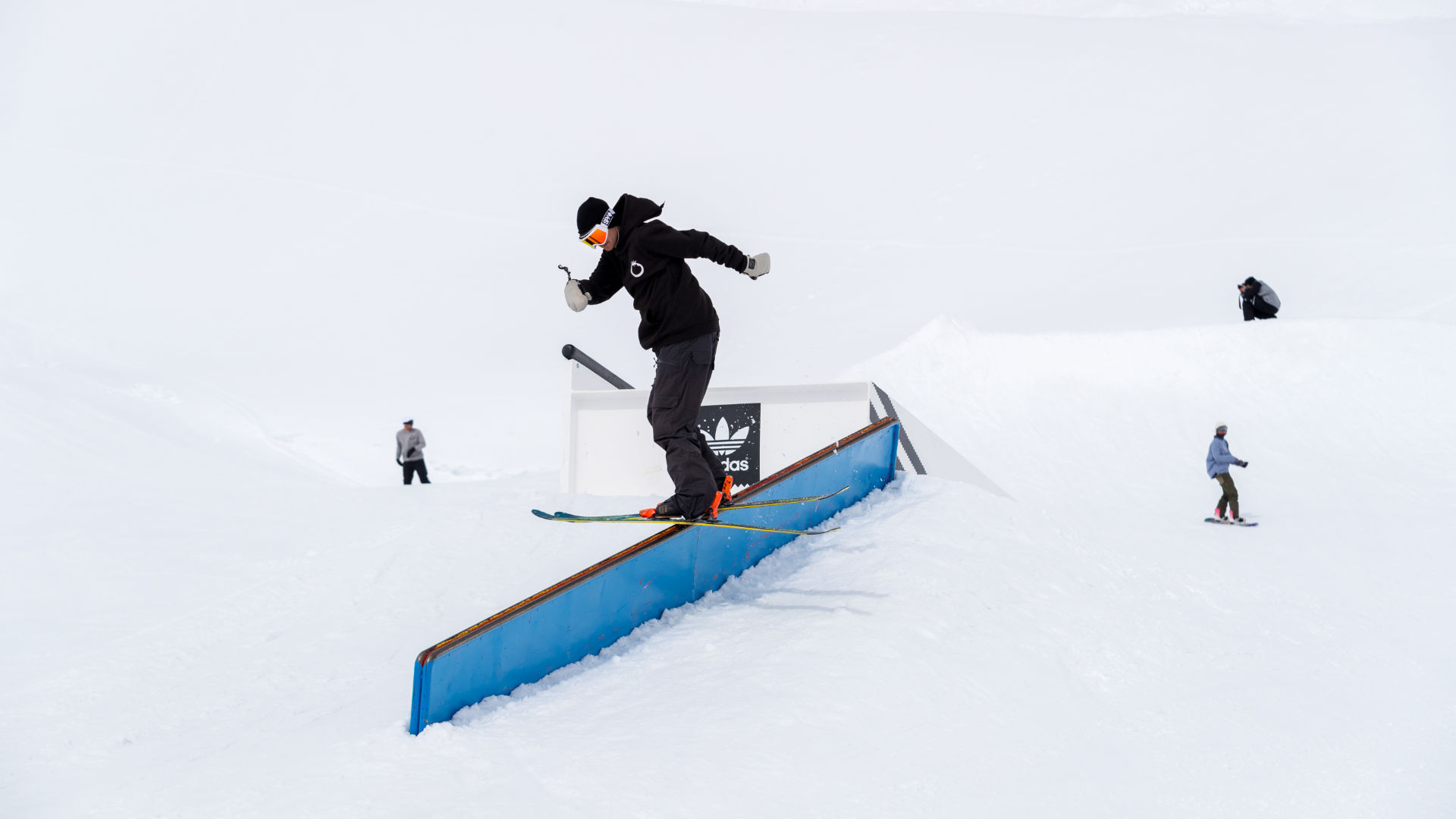 A Blue Tomato Team Rider on a rail at Nordkette