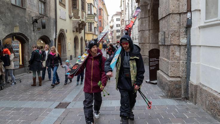 Skiers walking through Innsbruck