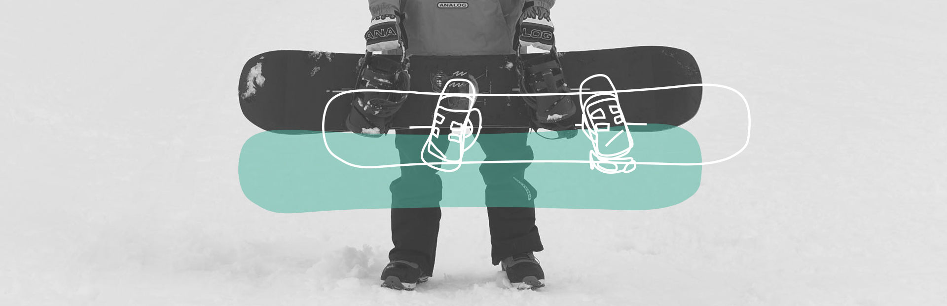 Snowboarder holding his snowboarding