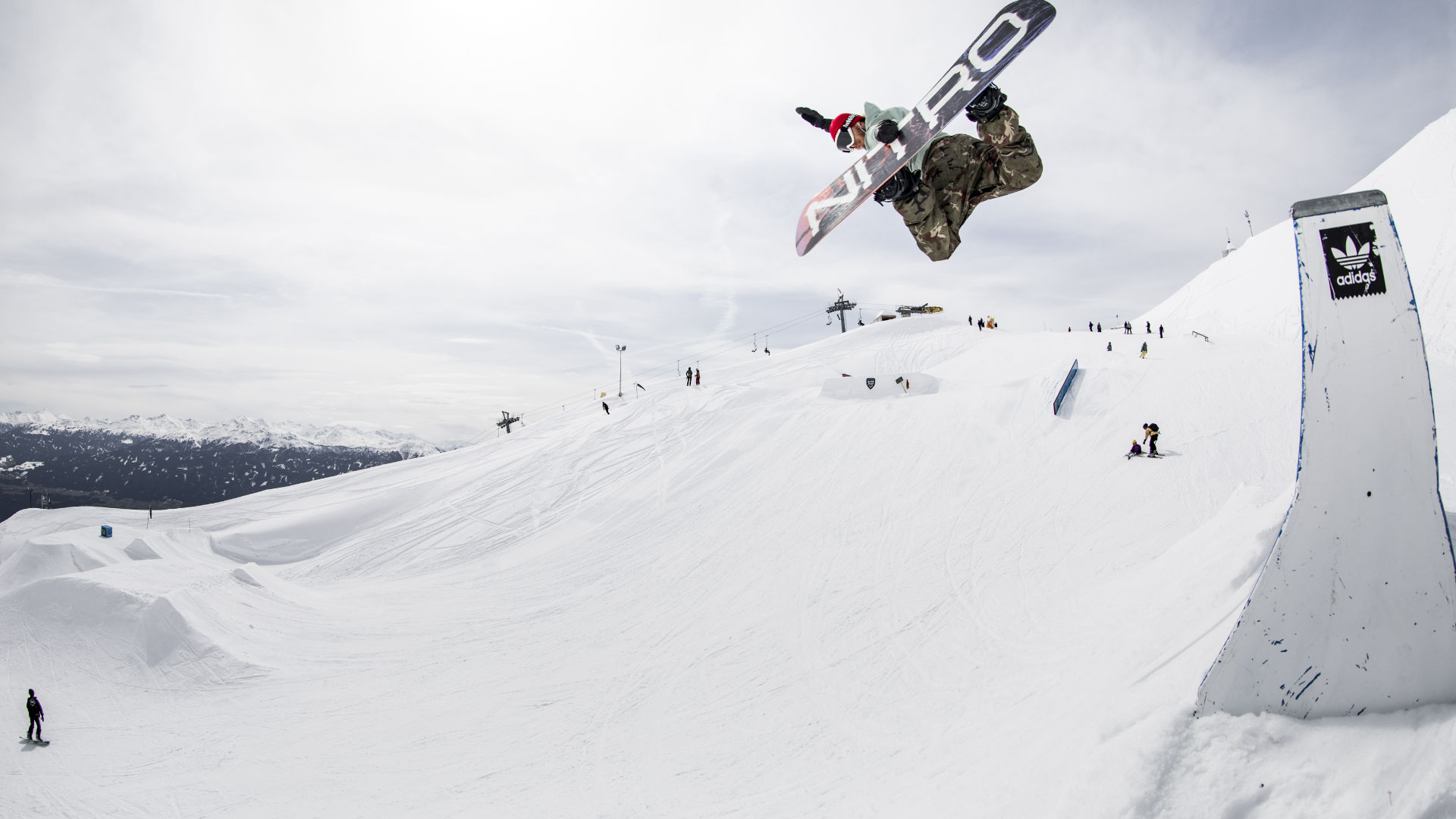 Blue Tomato Team Rider Dominik Wagner taking air with medium boots