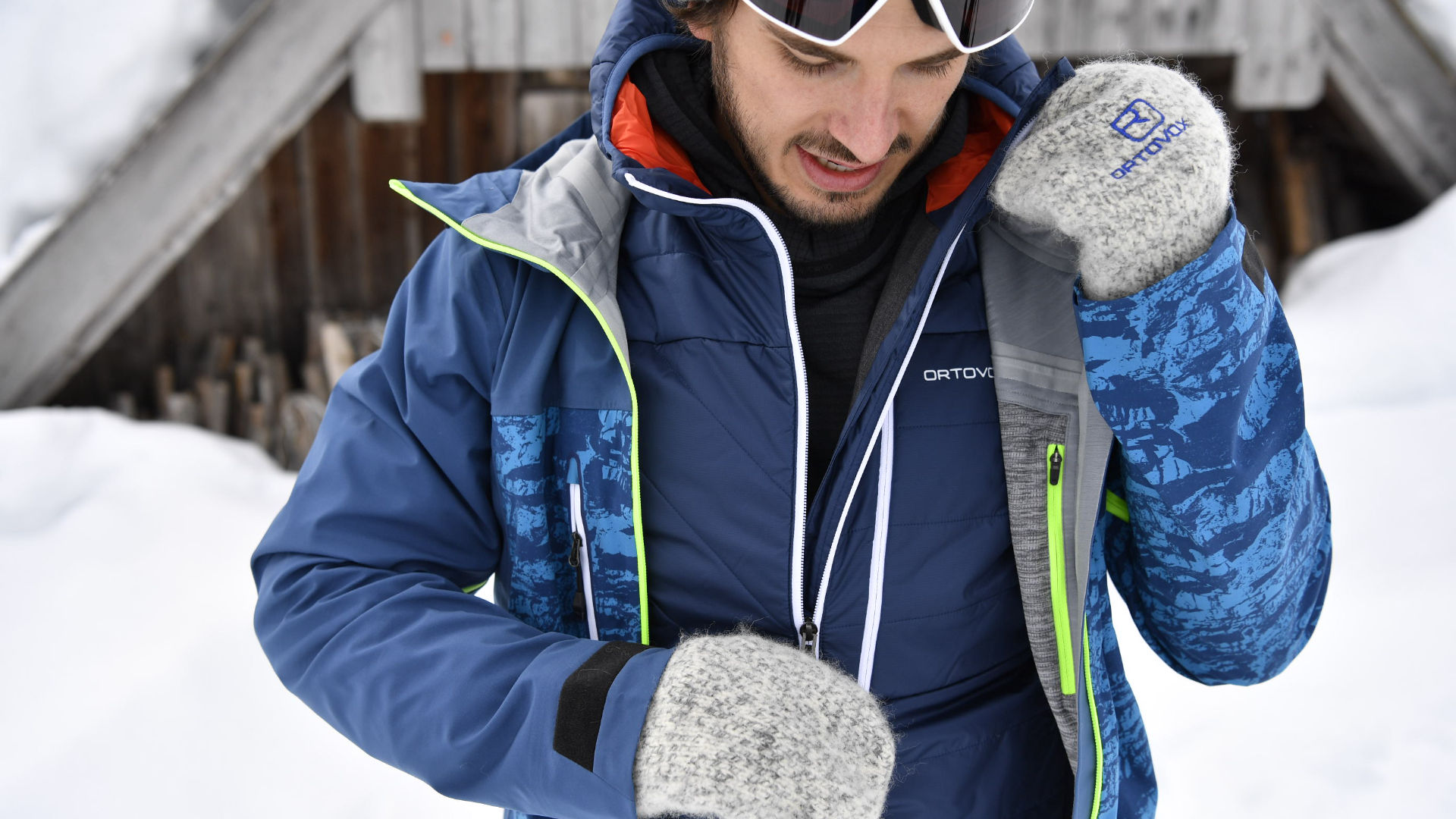 Male snowboarder using an insulator and jacket from Ortovox to keep warm
