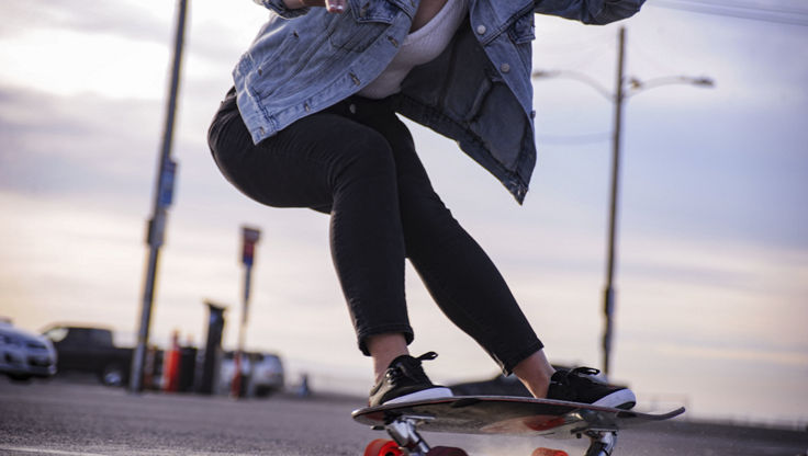 Young woman riding on her cruiser