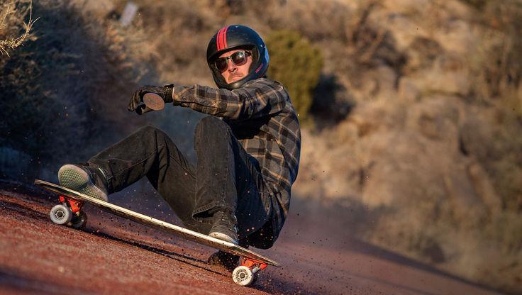 Longboarder doing freestyle tricks