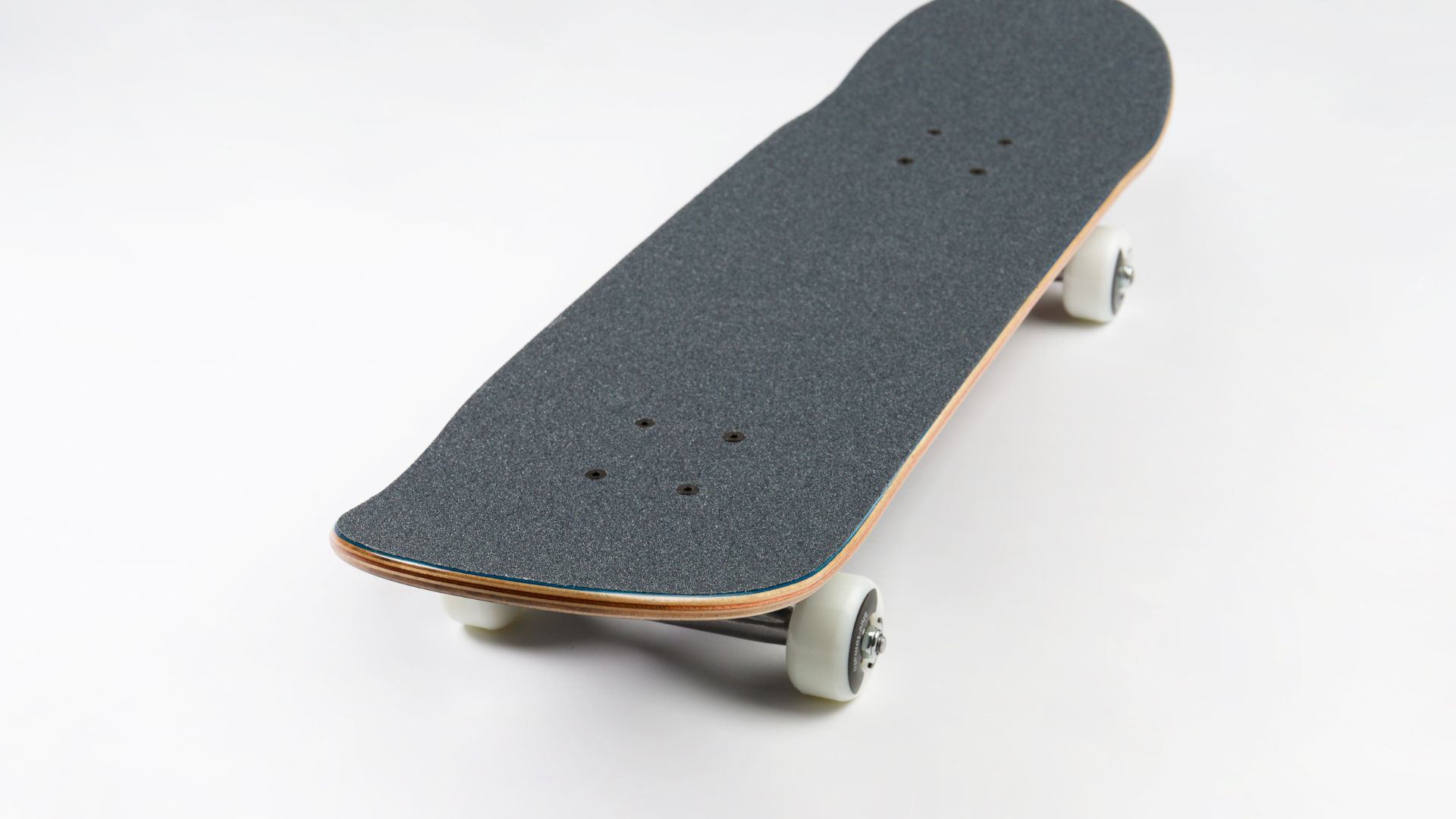Skateboard deck length from nose to tail