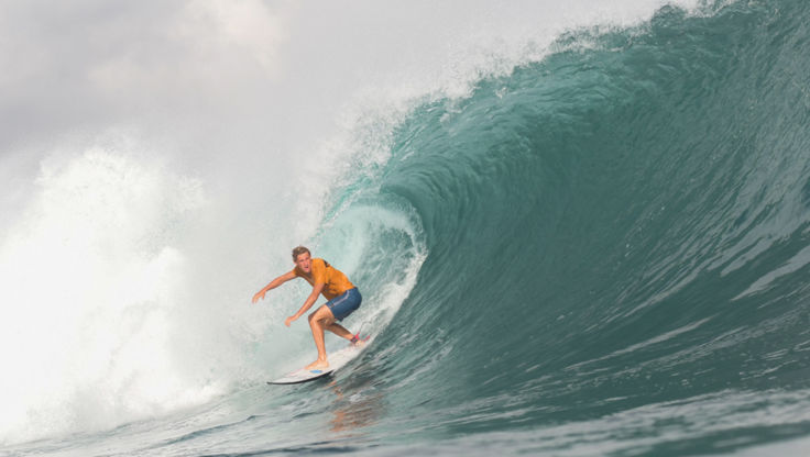 Blue Tomato team rider on a green wave